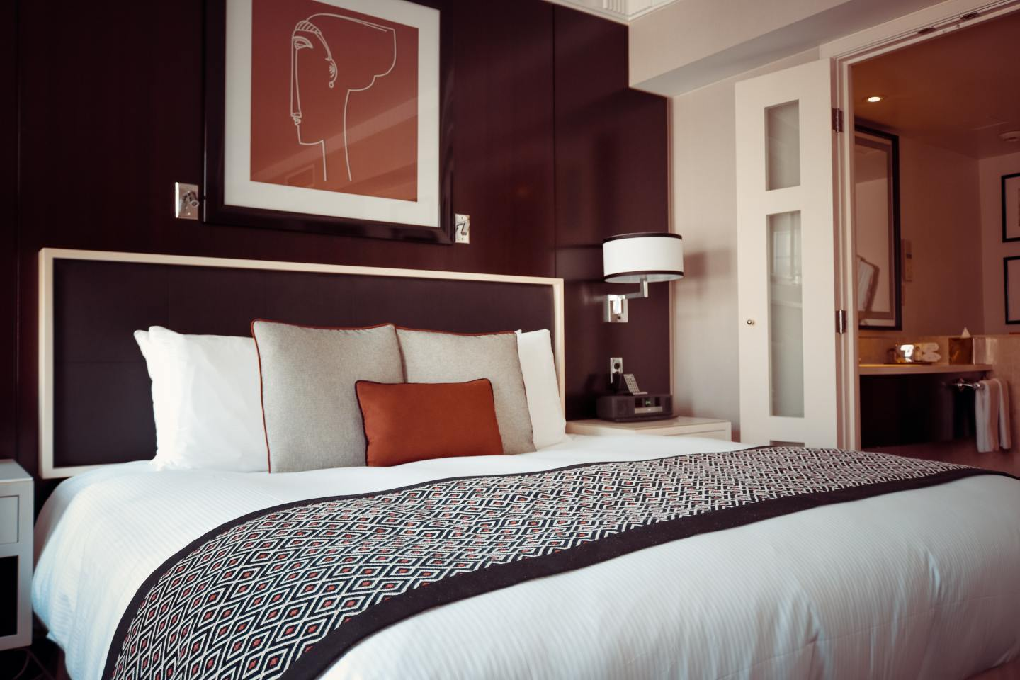 Beautiful hotel room and bed with cushions