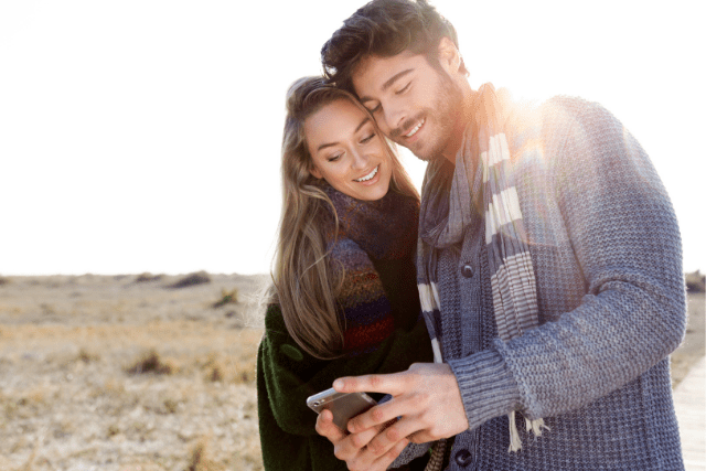 Confidence Man and woman looking at mobile phone