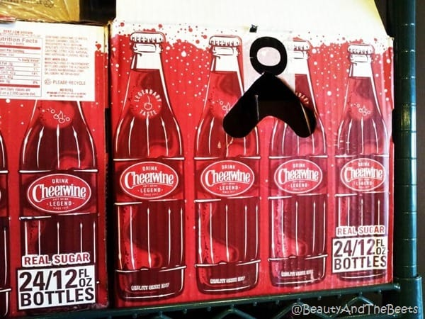a cardboard box of Cheerwine bottles