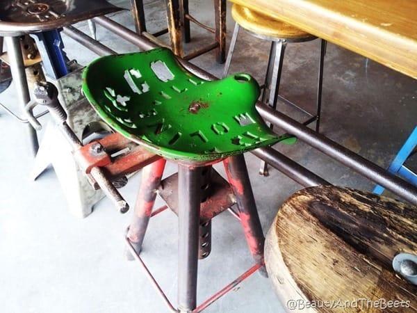 a random green antique chair on a concrete floor