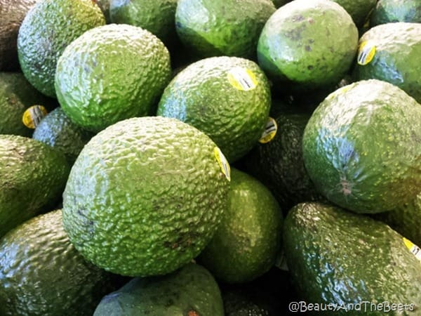 a pile of ripe green avocados for pea, avocado and radish stacks