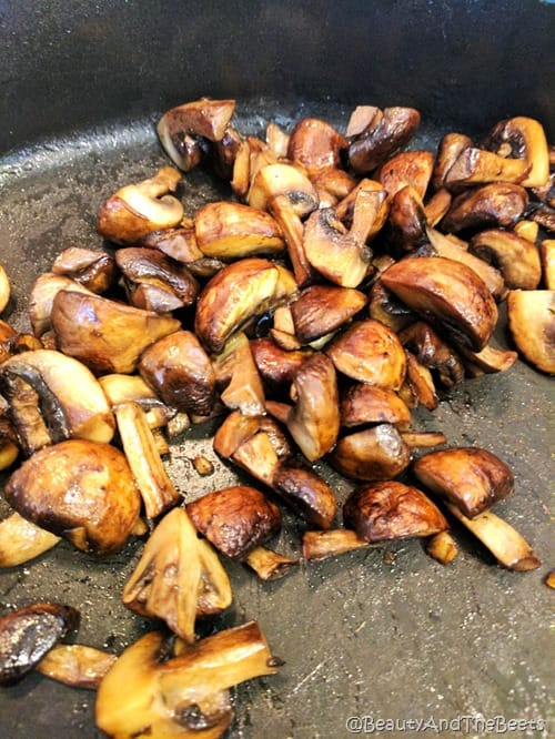 a cast iron pan of sauteed mushrooms and ginger