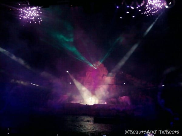 purple spotlights on smoke with mini fireworks in Fantasmic on the river