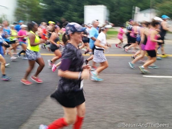 a blurred picture of the author running in Virginia Beach