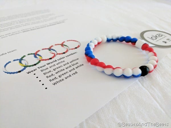 a red white and blue bead bracelet on a piece of paper with pictures of the other bracelets