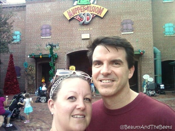 The author and Mr Beet standing in front of the Muppets #D red brick building