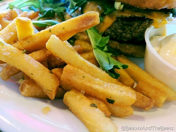 a plate of crispy golden fries on a white plate