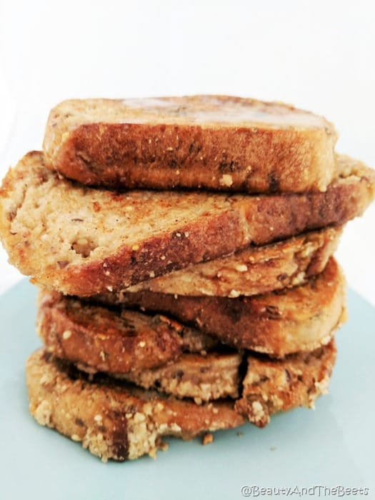 a stack of thick whole grain bread Cashew Vegan French Toast on a blue plate