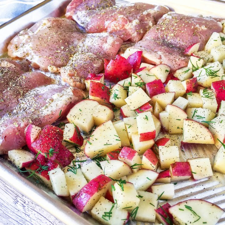 potatoes and chicken on a sheet pan