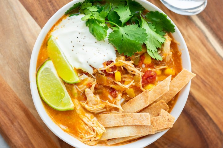 tortilla soup in a bowl with sour cream