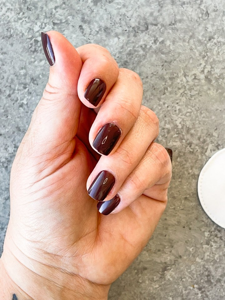 left hand with press on nail set on