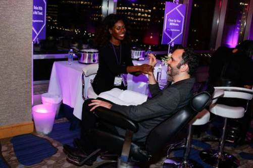"""James Beard Award-winning pastry chef and Cronut® creator Dominique Ansel gets a menicure at the on-the-go beauty bar, created by fashion designer Cynthia Rowley and tech mogul and businesswoman Randi Zuckerberg, at the Hyatt Regency """"It's Good Not To Be Home"""" event. Photo Credit: Mansueto Ventures"""