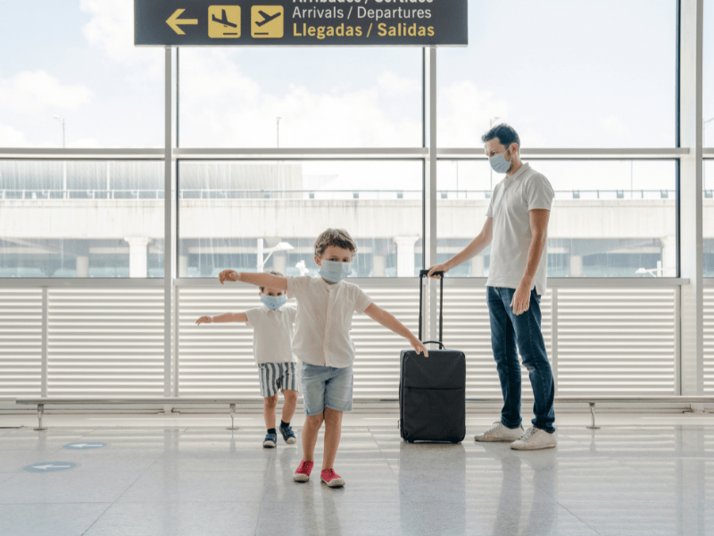Family travel in airport during pandemic