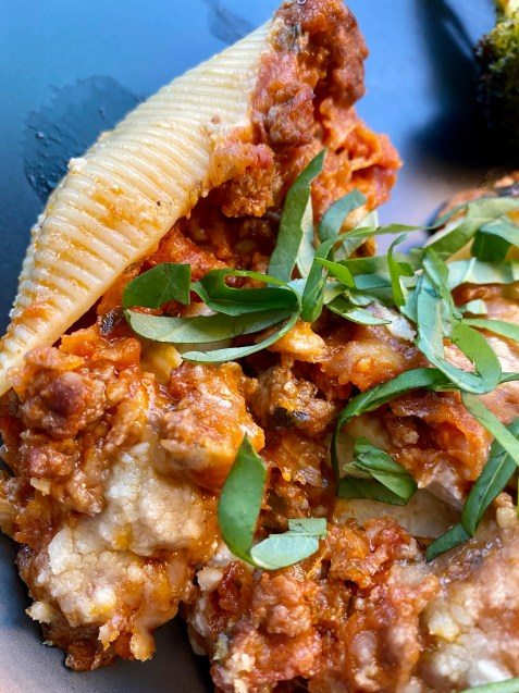 Delicious and healthy Cheesy Stuffed Shells the whole family will love! This easy weeknight dinner is great for LEFTOVERS! Which means, cook once, and enjoy all week! #food #family #recipes #pasta #italian #healthyfood #dinner