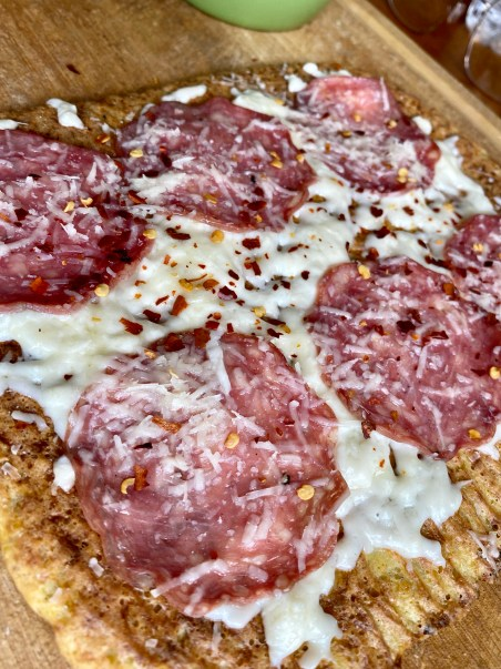 A healthy and hearty KETO pizza! Made with cauliflower and almond flour, this paleo pizza packs 68 grams of protein and is SO DELICIOUS! #glutenfree #keto #paleo #lowcarb #pizza #food #recipe #edrecovery #cooking #cauliflower