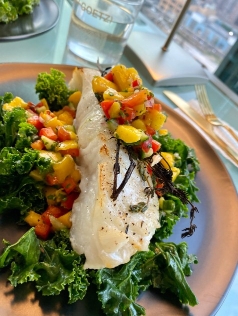 """Need to """"wow"""" someone with your cooking skills? THIS IS THE RECIPE! Chilean Sea Bass with Mango Salsa! This gluten free and paleo recipe is a crowd pleaser! Perfect for a dinner party, is make-ahead friendly and super fast and easy! PLUS ITS DANG DELICIOUS! #food #cooking #healthyfood #paleo #kale #edrecovery #recipe #health #dairyfree #dinner"""