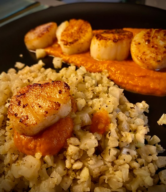 """DATE NIGHT, ELEVATED! Scallops Diavolo! Italian for """"devil,"""" this spicy red sauce pairs perfectly with pan seared scallops and cauliflower rice! This super EASY and delicious keto recipe is gorgeous, healthy, and FAST! #food #healthyfood #cooking #scallops #keto #paleo #lowcarb #glutenfree #datenight #dinner"""