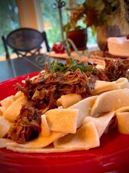 Sharing my mom's FAMOUS recipe that has been a family secret until now! BEEF OVER NOODLES! Slow cooked, melt-in-you-mouth beef - made in the crock pot - served over buttery egg noodles! An easy and delicious dinner! #keto #cooking #recipe #dinner #paleo #glutenfree #healthyfood #family #health #food