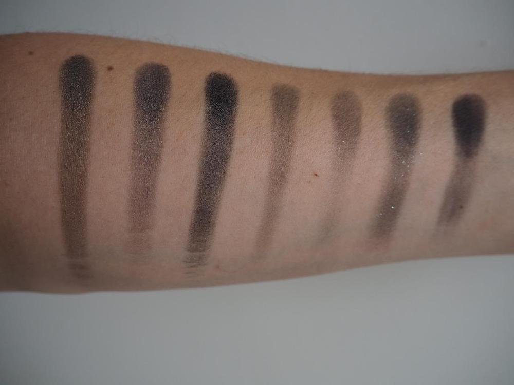 Row of eyeshadow swatches on my arm from Morphe 35d palette Grey and black