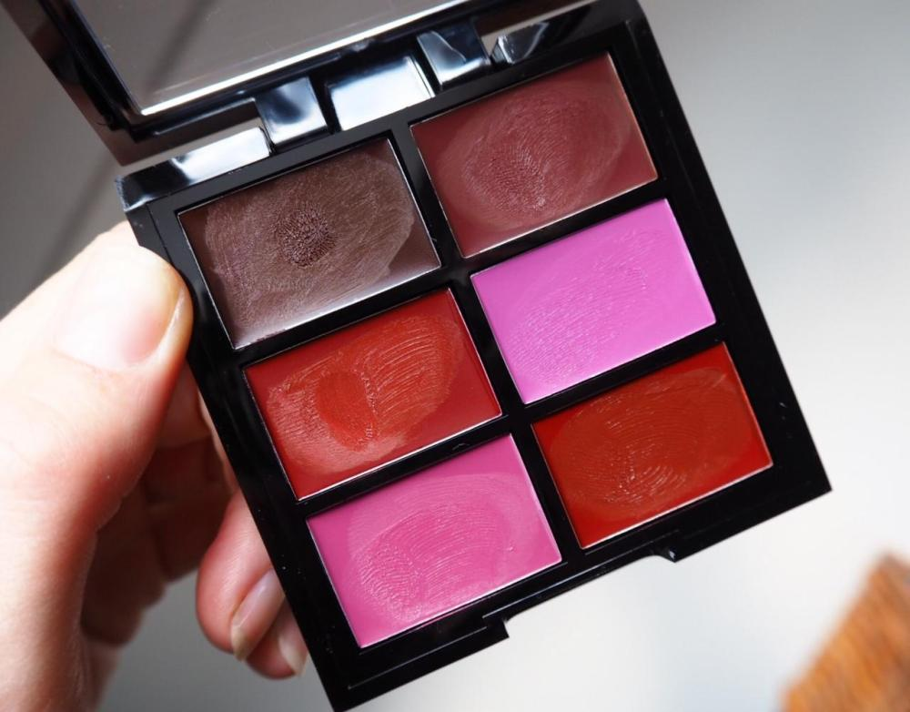 nyx pro lip cream palette in the plums photo of open palette displaying colours
