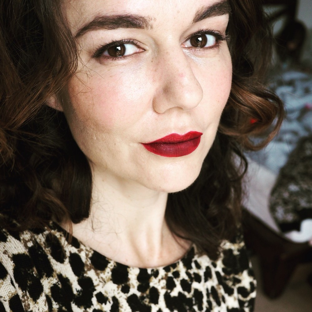 brown haired lady with red lipstick