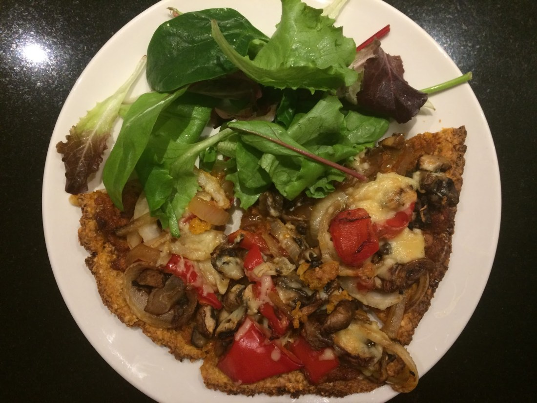 plate with pizza and salad