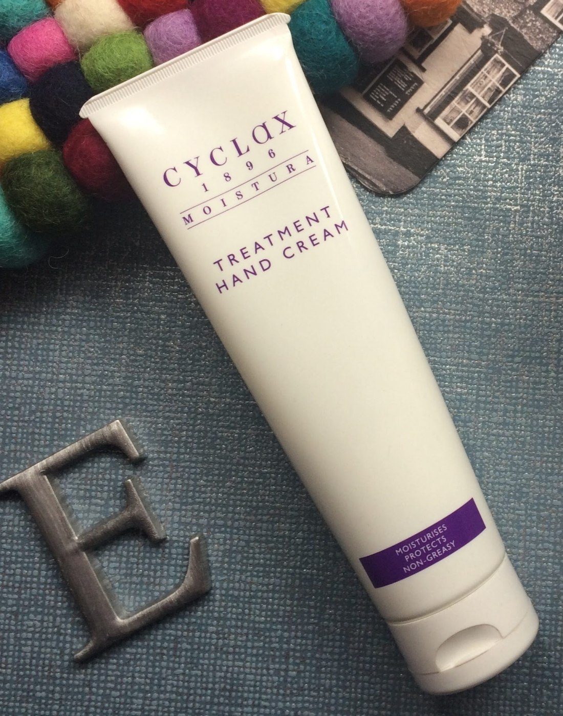 Cylax hand cream and metal capital E