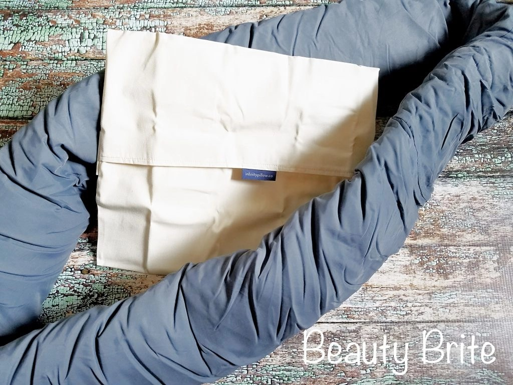 Infinity Pillow unrolled with storage bag