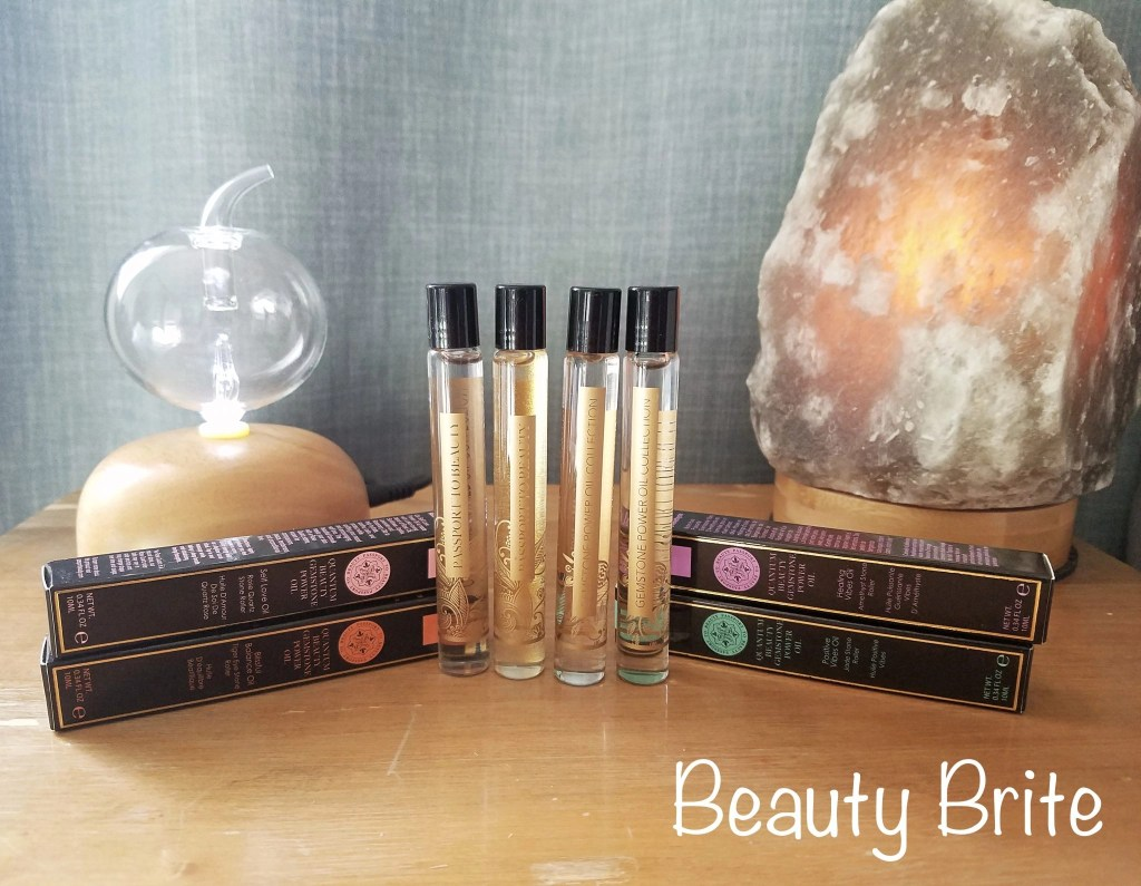 Gemstone Power Oil Collection: Jade Energizing Power Oil, Amethyst Healing Power Oil, Rose Quartz Self Love Power Oil, and Tiger Eye Bliss And Balance Oil.