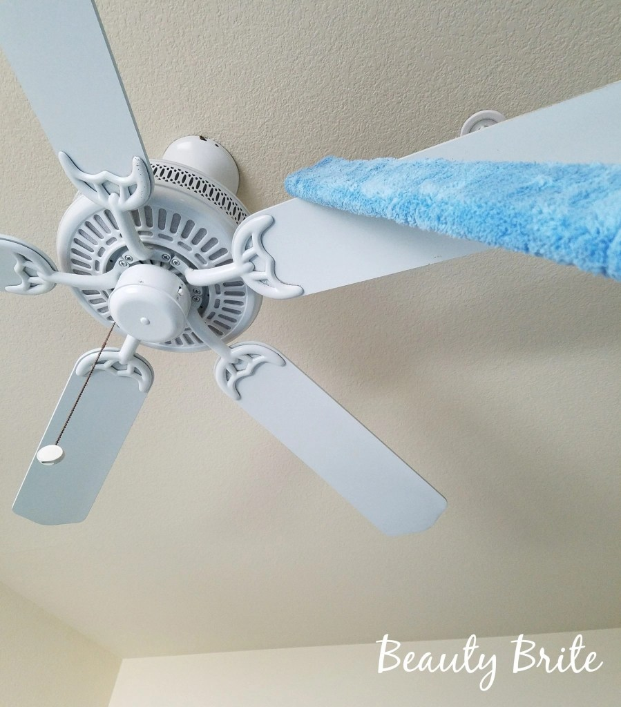 Using the Cleaning & Dusting Wand to dust the ceiling fan