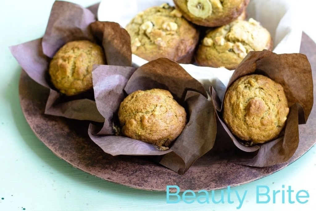 Pumpkin Spice Banana Nut Nut Muffins displayed on tray