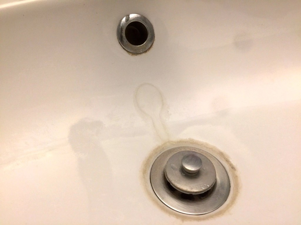 Bathroom sink before cleaning with CLR Calcium Lime & Rust cleaner.