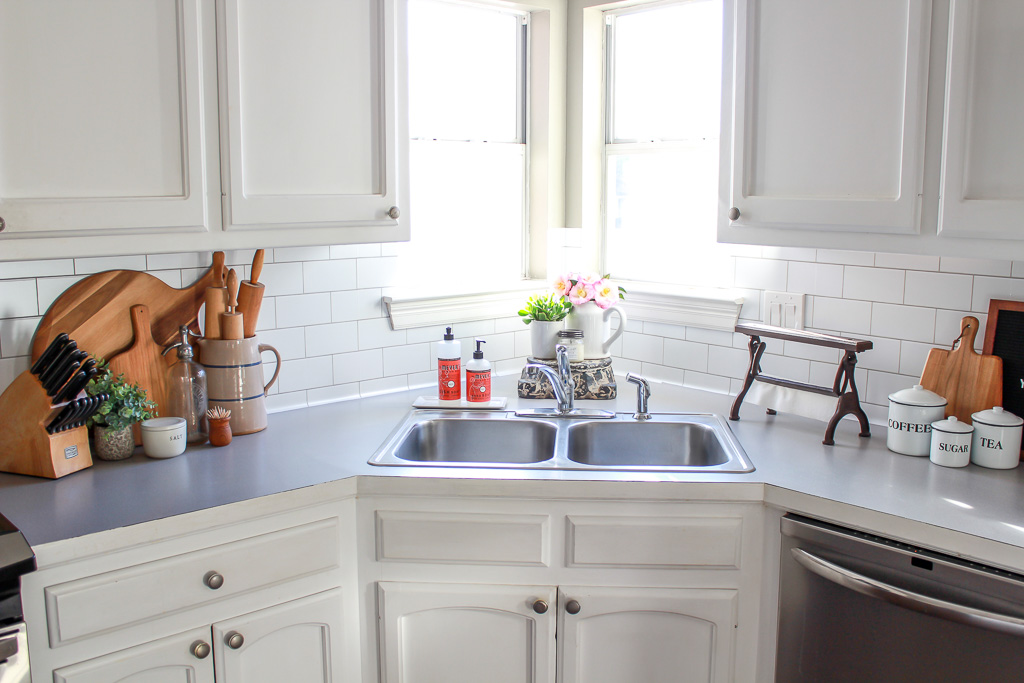 Get the fixer upper look on a budget by putting up a textured subway tile backsplash using peel and stick wallpaper from target.