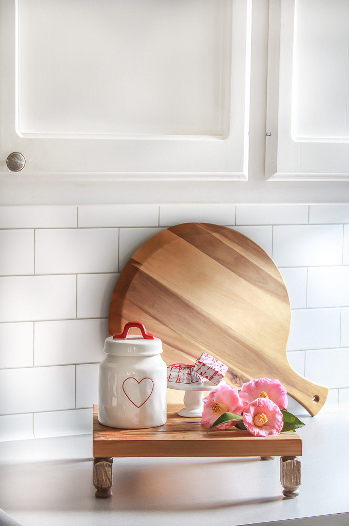 Learn how to make a wooden riser in about 30 minutes with only 3 supplies. These risers are so cute to style just about anything on. They are the perfect farmhouse addition.
