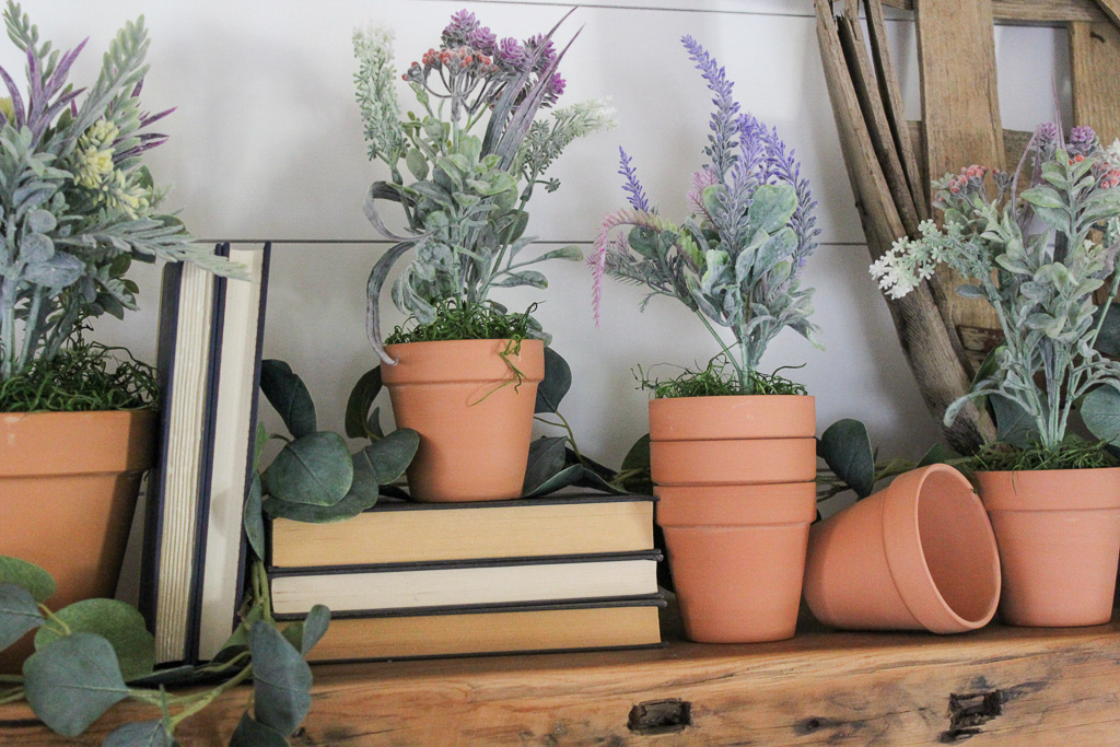 How I created a farmhouse Easter Mantel for less than $20 by using supplies from the Dollar Tree and a little creativity.