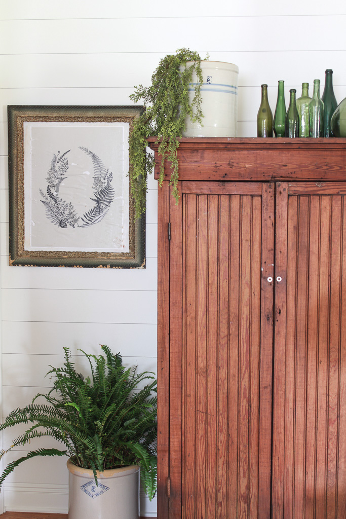 Learn how I transformed a flea market painting to a mod podge masterpiece. This is a budget-friendly hack for those who like to change up their decor often.