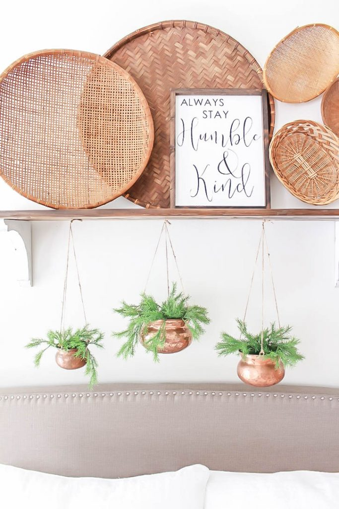 A fun and original way to style the wall over your headboard. This idea is perfect for any style bedroom or headboard and brings lots of character and textures to your space.