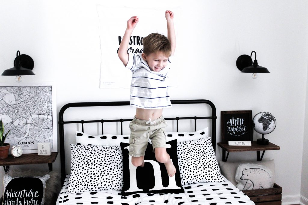 A monochrome boys room makeover with a modern vintage vibe. This is such a fun space for a kid and even includes a cozy reading nook.
