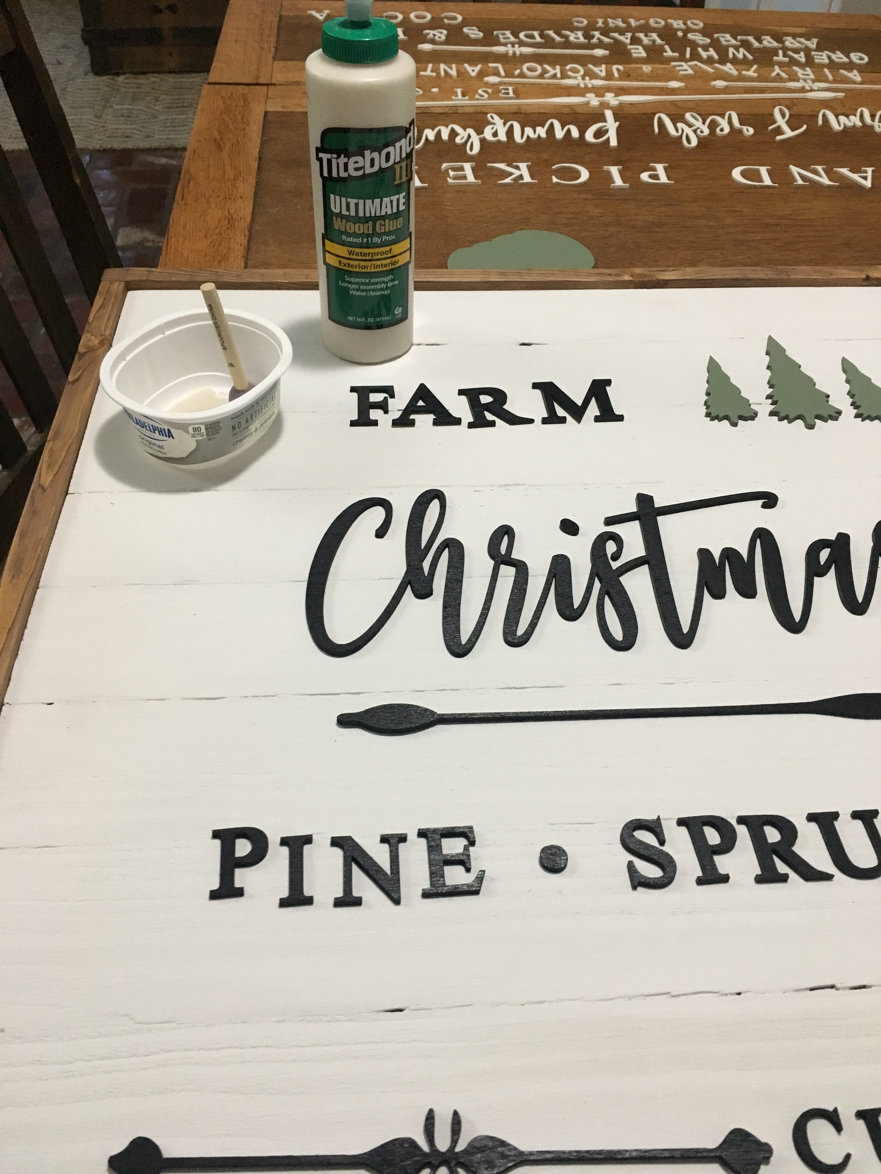 Learn how to make a DIY Christmas sign that doubles for a fall sign. Just flip the sign over from one season to the next for an easy transition!