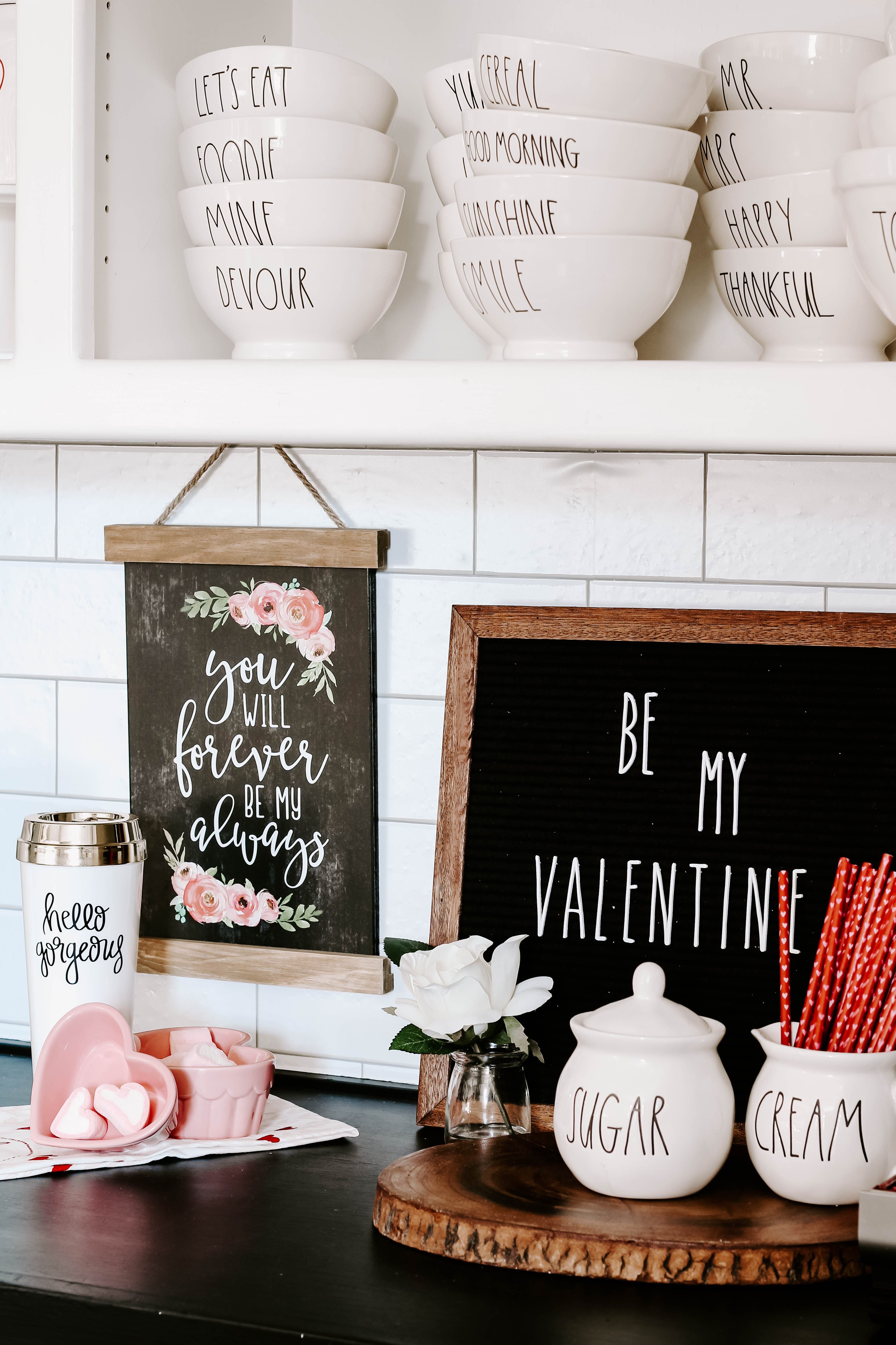 See how I created a farmhouse style Valentine coffee bar with lots of Rae Dunn and small touches of pink and red Valentine decor. #valentinecoffeebar
