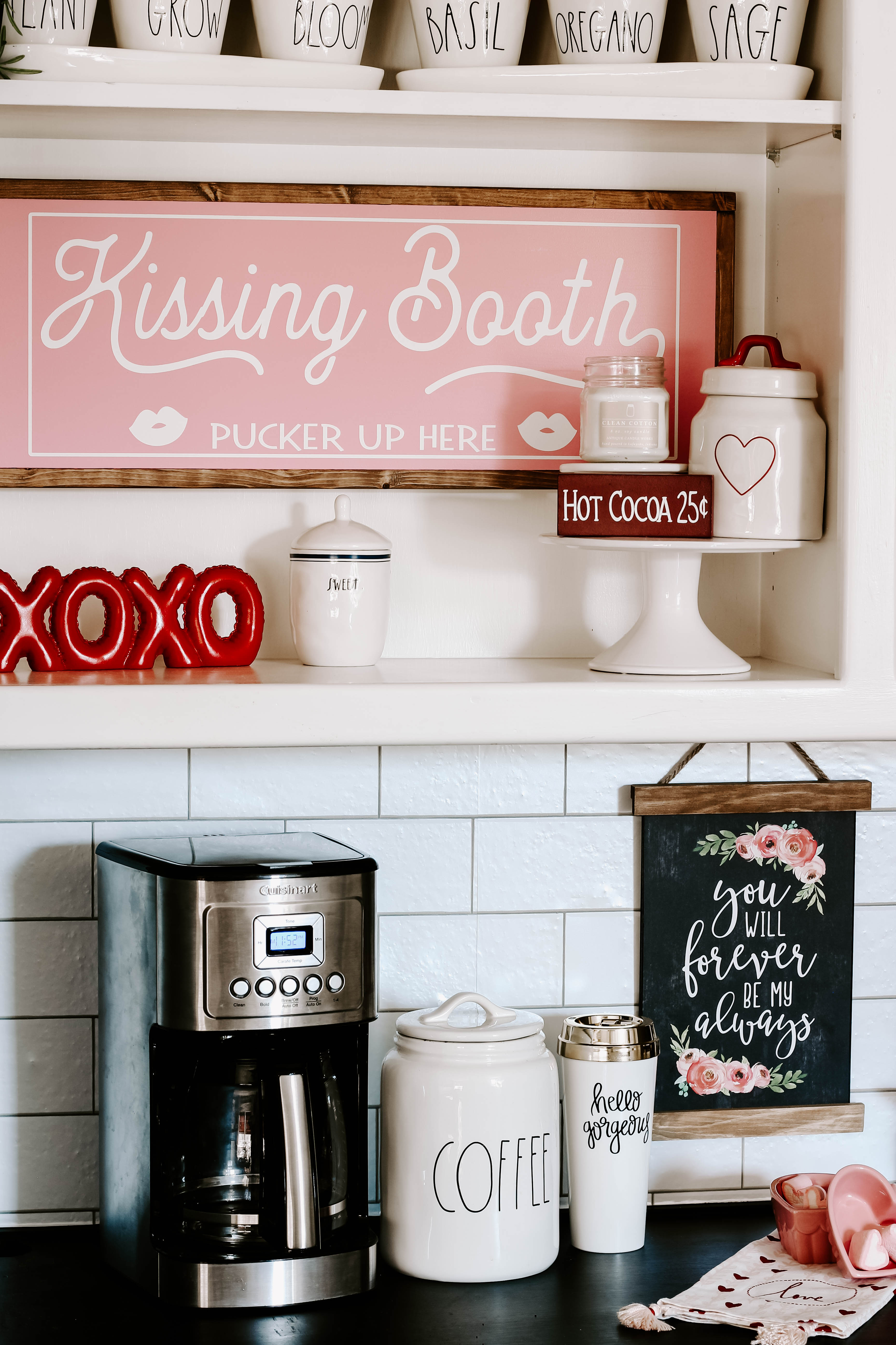 See how I created a farmhouse style Valentine coffee bar with lots of Rae Dunn and small touches of pink and red Valentine decor. #valentinedecorations