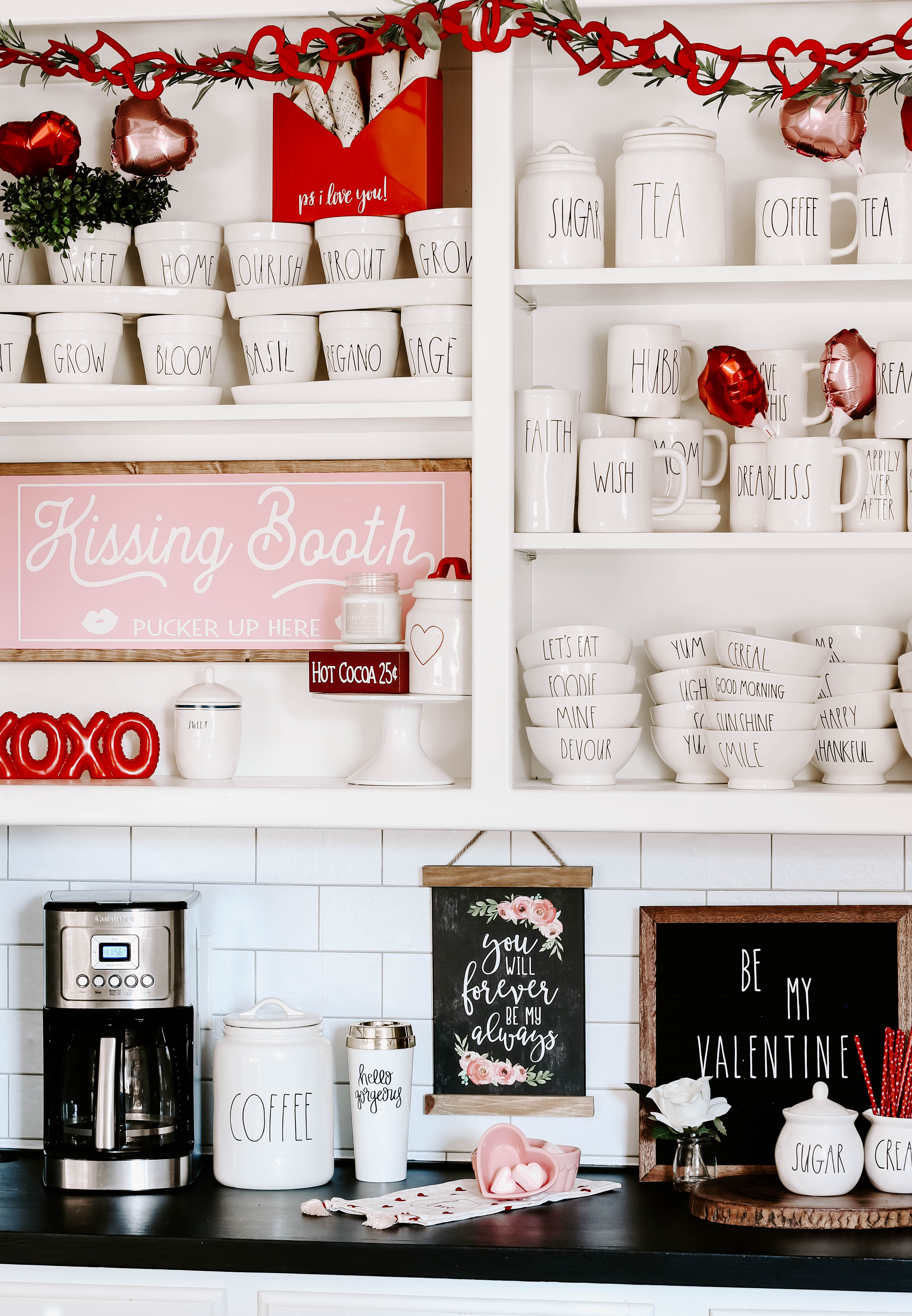 See how I created a farmhouse style Valentine coffee bar with lots of Rae Dunn and small touches of pink and red Valentine decor. #raedunncoffeebar