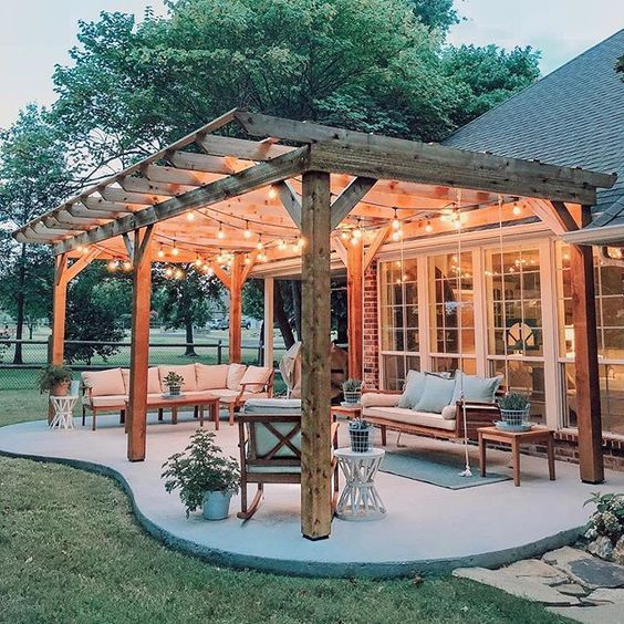 A dreamy outdoor patio with a pergola and market lights.