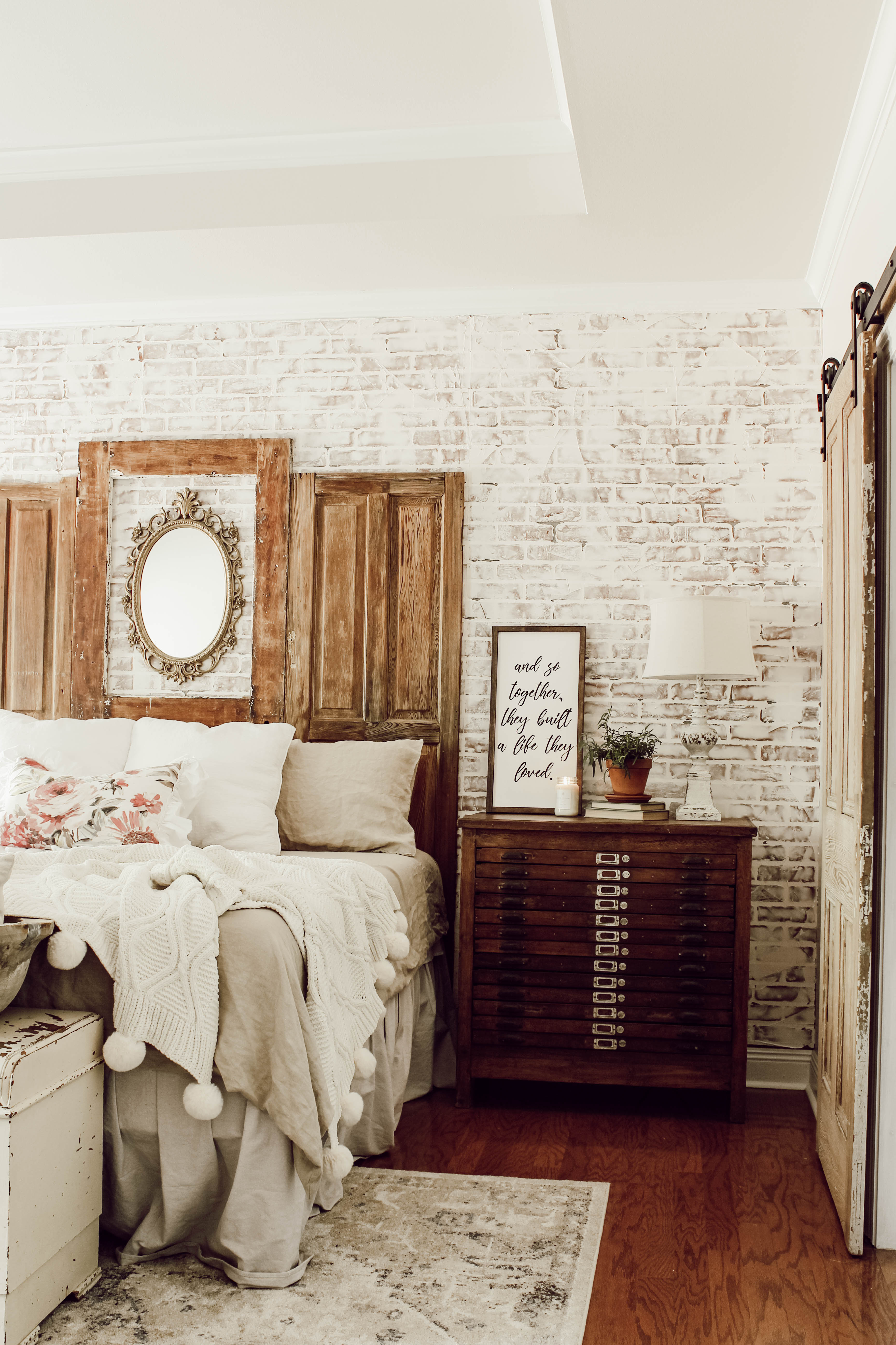 A vintage bedroom makeover with printer's cabinet.