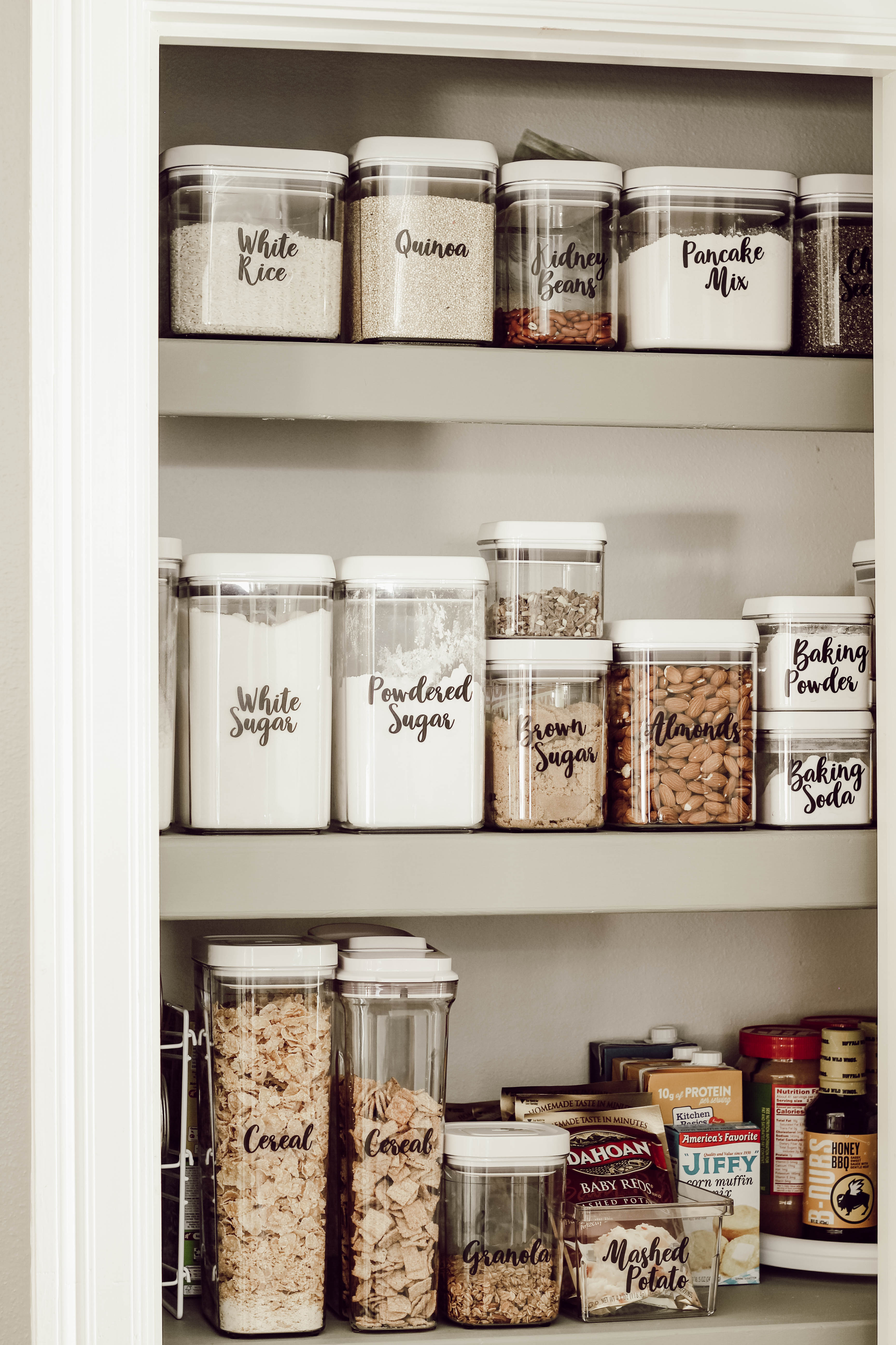 labeled canisters in a kitchen pantry