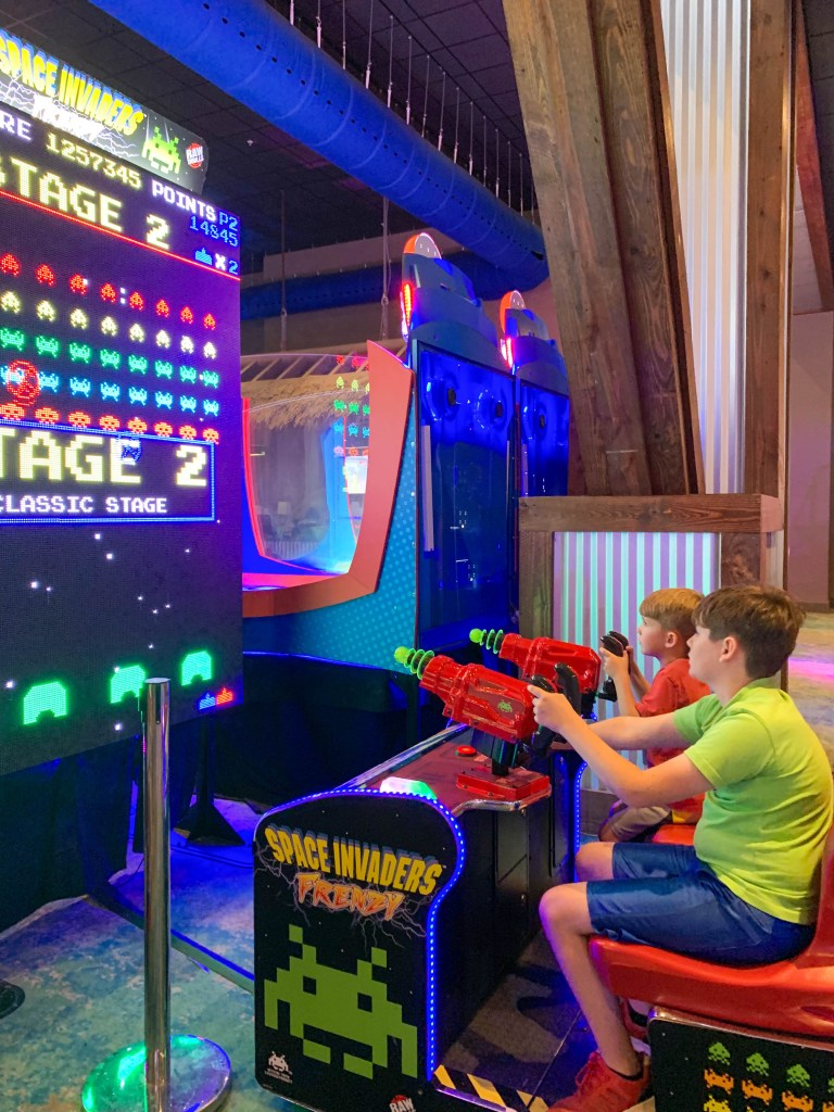 Kids playing Space Invaders at Escape Arcade.
