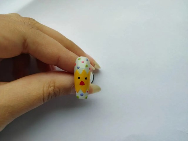 Chicken in the egg nail art