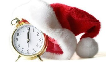 red and white santa hat on a gold alarm clock. christmas gifts for mom