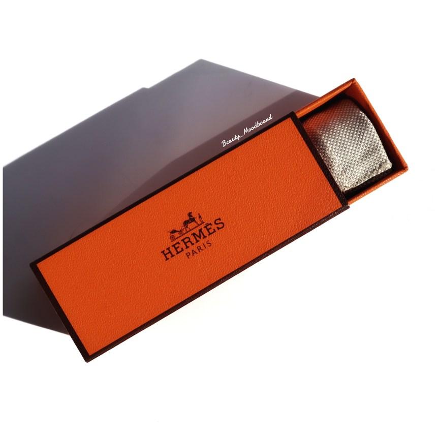 Etui orange rouge à lèvres de la grande maison de la sellerie et maroquinerie française