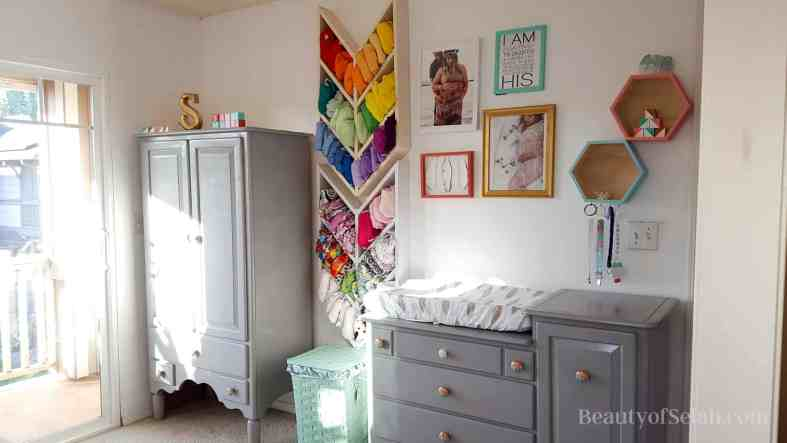 Elegant-Ombre-Herringbone-Nursery second main wall with dressers, herringbone shelves, and wall art